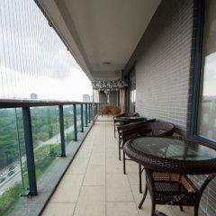Отель Yunlv Youth Hostel Китай, Шэньчжэнь - отзывы, цены и фото номеров - забронировать отель Yunlv Youth Hostel онлайн балкон