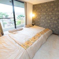 Отель GUESTHOUSE HAKOZAKI GARDEN - Hostel Япония, Фукуока - отзывы, цены и фото номеров - забронировать отель GUESTHOUSE HAKOZAKI GARDEN - Hostel онлайн комната для гостей