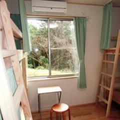 Отель Guesthouse Yakushima Япония, Якусима - отзывы, цены и фото номеров - забронировать отель Guesthouse Yakushima онлайн комната для гостей фото 2