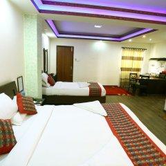 Отель Alpine Hotel & Apartment Непал, Катманду - отзывы, цены и фото номеров - забронировать отель Alpine Hotel & Apartment онлайн комната для гостей