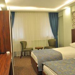 Отель Madi Otel Izmir комната для гостей фото 3