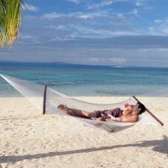 Отель Treasure Island Resort пляж фото 2
