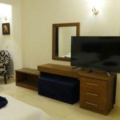Отель Seashore Homes удобства в номере фото 2