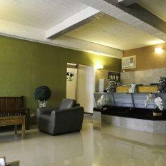 Отель Makati International Inns Филиппины, Макати - 1 отзыв об отеле, цены и фото номеров - забронировать отель Makati International Inns онлайн интерьер отеля фото 3