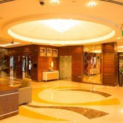 Отель Park Regis Kris Kin Hotel ОАЭ, Дубай - 10 отзывов об отеле, цены и фото номеров - забронировать отель Park Regis Kris Kin Hotel онлайн интерьер отеля фото 3