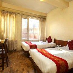 Отель OYO 144 Hotel Zhonghau Непал, Катманду - отзывы, цены и фото номеров - забронировать отель OYO 144 Hotel Zhonghau онлайн комната для гостей фото 2