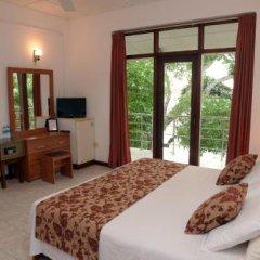 Отель Riverside Inn Fuji Шри-Ланка, Бентота - отзывы, цены и фото номеров - забронировать отель Riverside Inn Fuji онлайн сейф в номере