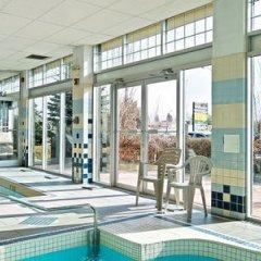 Отель Econo Lodge South Calgary Канада, Калгари - отзывы, цены и фото номеров - забронировать отель Econo Lodge South Calgary онлайн фитнесс-зал фото 3