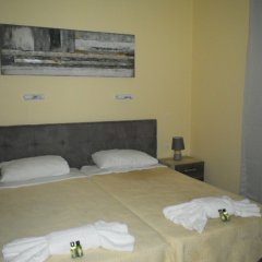 Апартаменты Nikos Apartments комната для гостей фото 3