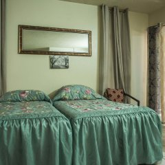Отель Starfish Beach Studio At Montego Bay Club Resort Ямайка, Монтего-Бей - отзывы, цены и фото номеров - забронировать отель Starfish Beach Studio At Montego Bay Club Resort онлайн комната для гостей