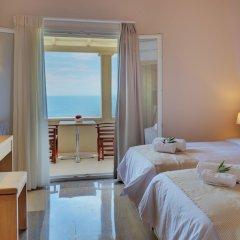 Апартаменты Krouzeri Beach Apartments комната для гостей фото 2