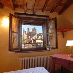 Отель Tognazzi Casa Vacanze - La Viola Италия, Сан-Джиминьяно - отзывы, цены и фото номеров - забронировать отель Tognazzi Casa Vacanze - La Viola онлайн удобства в номере
