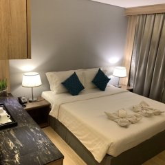 Отель Green Suites at Bel Air Soho Филиппины, Макати - отзывы, цены и фото номеров - забронировать отель Green Suites at Bel Air Soho онлайн комната для гостей фото 3