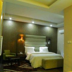 Отель Golden Tulip Essential Benin City комната для гостей фото 5