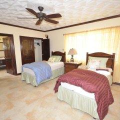 Отель Dukes Hideaway, Silver Sands 6BR комната для гостей