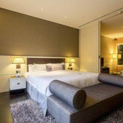 Отель Ascott Raffles Place Singapore комната для гостей