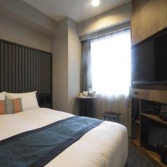 Отель THE KNOT TOKYO Shinjuku сейф в номере