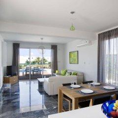 Отель Paradise Cove Luxurious Beach Villas Кипр, Пафос - отзывы, цены и фото номеров - забронировать отель Paradise Cove Luxurious Beach Villas онлайн комната для гостей фото 4
