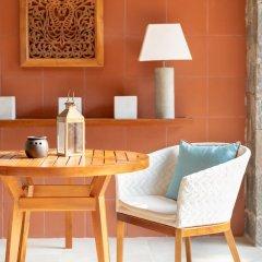 Отель Bentota Beach by Cinnamon Шри-Ланка, Бентота - отзывы, цены и фото номеров - забронировать отель Bentota Beach by Cinnamon онлайн удобства в номере фото 2