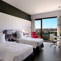 Отель Hilton Madrid Airport Мадрид комната для гостей фото 4