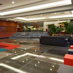 Отель Oasis Palm Hotel Мексика, Канкун - 9 отзывов об отеле, цены и фото номеров - забронировать отель Oasis Palm Hotel онлайн интерьер отеля фото 2