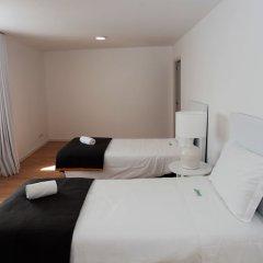 Отель Azorean Flats by Green Vacations Португалия, Понта-Делгада - отзывы, цены и фото номеров - забронировать отель Azorean Flats by Green Vacations онлайн комната для гостей