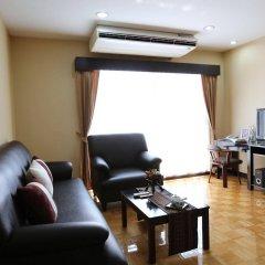 Апартаменты J Town serviced Apartments комната для гостей