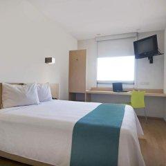 Отель One Patriotismo Мехико комната для гостей фото 4