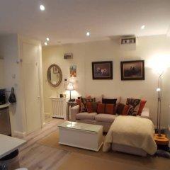 Отель Cosy Central 1 Bedroom Flat With Shared Roof Terrace & Gym Лондон фото 8