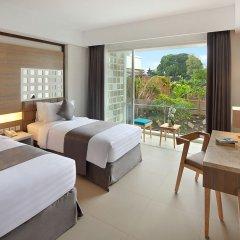 Отель Jimbaran Bay Beach Resort & Spa комната для гостей фото 2