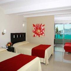 Отель Las Flores Beach Resort сейф в номере