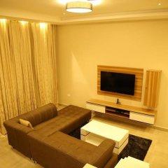 Отель Kiniz Luxury Apartments Нигерия, Уйо - отзывы, цены и фото номеров - забронировать отель Kiniz Luxury Apartments онлайн комната для гостей фото 2