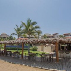 Отель The Residences at Las Palmas Мексика, Коакоюл - отзывы, цены и фото номеров - забронировать отель The Residences at Las Palmas онлайн гостиничный бар