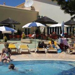 Отель Oasis Parque Country Club Портимао бассейн фото 3