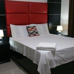 Отель Luxury Suites A Филиппины, Пампанга - отзывы, цены и фото номеров - забронировать отель Luxury Suites A онлайн комната для гостей фото 2