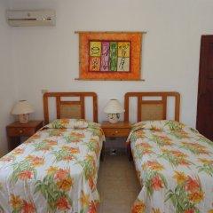 Отель Angel Gabriel Доминикана, Бока Чика - отзывы, цены и фото номеров - забронировать отель Angel Gabriel онлайн комната для гостей фото 4
