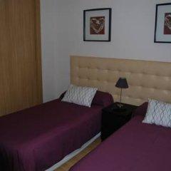 Отель Aparthotel Encasa Испания, Мадрид - отзывы, цены и фото номеров - забронировать отель Aparthotel Encasa онлайн комната для гостей фото 2