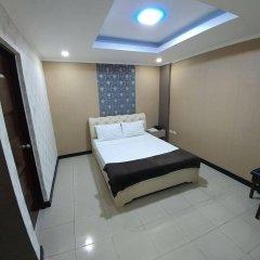 Отель OYO 700 Pj Inn Hotel Филиппины, Пампанга - отзывы, цены и фото номеров - забронировать отель OYO 700 Pj Inn Hotel онлайн комната для гостей фото 3