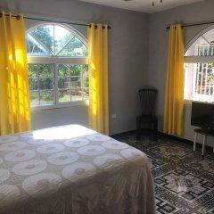 Отель Retreat Comfortable Apartments Ямайка, Фалмут - отзывы, цены и фото номеров - забронировать отель Retreat Comfortable Apartments онлайн комната для гостей фото 2