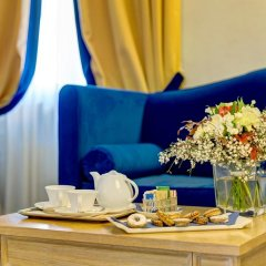 Villa Tolomei Hotel & Resort в номере