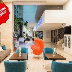 TRYP Lisboa Oriente Hotel интерьер отеля