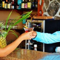 Отель Beachcombers Hotel Сент-Винсент и Гренадины, Остров Бекия - отзывы, цены и фото номеров - забронировать отель Beachcombers Hotel онлайн фото 2