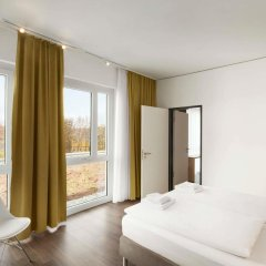 Отель Super 8 Munich City North комната для гостей