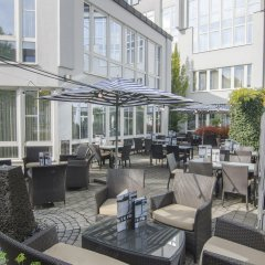 Отель Holiday Inn Munich-Unterhaching Германия, Унтерхахинг - 7 отзывов об отеле, цены и фото номеров - забронировать отель Holiday Inn Munich-Unterhaching онлайн гостиничный бар