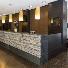 Отель NH Danube City Австрия, Вена - отзывы, цены и фото номеров - забронировать отель NH Danube City онлайн интерьер отеля