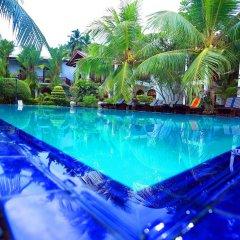 Отель Bentota Village Шри-Ланка, Бентота - отзывы, цены и фото номеров - забронировать отель Bentota Village онлайн бассейн фото 3