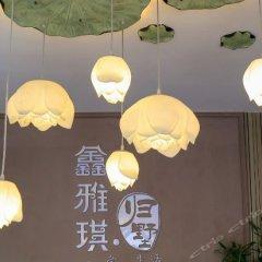 Xinyaqi Hotel интерьер отеля
