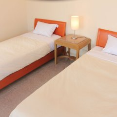 Отель Cottage Seaside Центр Окинавы комната для гостей
