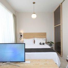 Отель Live in Athens Acropolis Suites комната для гостей