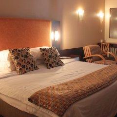 Отель Nike Lake Resort Нигерия, Энугу - отзывы, цены и фото номеров - забронировать отель Nike Lake Resort онлайн комната для гостей